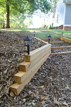 Sprucing Up Our Backyard: Fire Pit & Garden Lights Retaining Wall Steps, Backyard Retaining Walls, Custom Shutters, Diy Shutters, Diy Fire Pit, Fire Pit Backyard, Wall Fires, Stair Lighting, Fire Pit Area