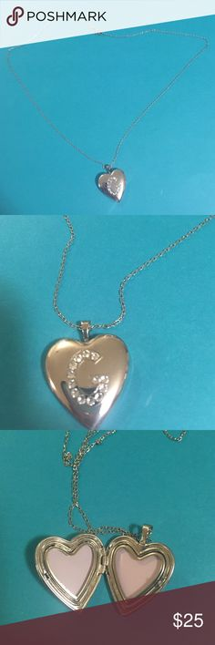 Large metal heart locket w/ sterling silver chain This is a large heart locket, it's about the size of a quarter, it says metal on the inside so I don't think it's sterling silver but the chain does have 925 engraved on it. It's very shiny and beautiful. The letter on the locket is a G. Jewelry Necklaces