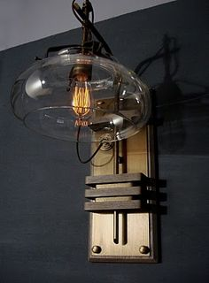 "One of my favorite steampunk sconces. Limited edition with hand-blown glass, solid brass, and mahogany by Art Donovan, author of ""The Art of Steampunk."" I really like Steampunk! Casa Steampunk, Lampe Steampunk, Steampunk Design, Steampunk Kitchen, Industrial Lighting, Cool Lighting, Industrial Design, Lighting Design, Industrial Chic"
