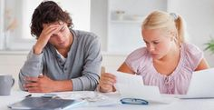 Worried couple looking over finances © Wavebreakmedia Ltd/Getty Images