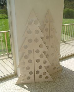 Plywood Christmas Tree - I want to do this. Christmas Wood Crafts, Unique Christmas Trees, Alternative Christmas Tree, Wooden Christmas Trees, Holiday Tree, Modern Christmas, Outdoor Christmas, Christmas Home, Christmas Ornaments