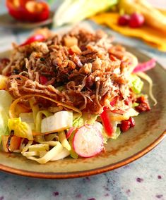This isn't your usual pulled pork recipe. I know some of you traditionalists will want the pork smothered in BBQ sauce in between a tasty Kaiser roll, but give this slow cooker recipe a chance! It's a salad, with pulled pork, and crispy maple lardons. WHAT?