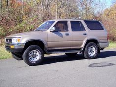 Gold 1995 Toyota 4Runner SR5. I paid $3000 for this replacement for the Corolla. It's been a perfect workhorse, and is close to 300,000 miles on the engine now.