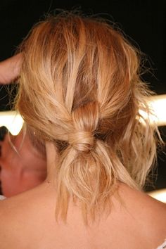 love this messy knot.  i think you'd best start with a pony, divide in two over the band, grab a section from under the....nevermindjustmesswithituntilitlooksgreat.