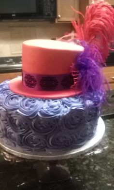 - Top tier (hat) is french vanilla almond covered in cherry fondant. Bottom tier is swiss chocolate with bavarian cream buttercream roses. Made for a friend's 60th birthday (Red Hat Society themed party)
