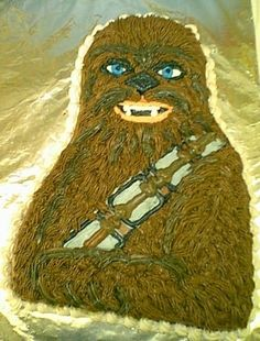 "CHEWBACCA - Shape cut from a 1/4 sheet cake.Chocolate buttercream icing ""hair"" applied with a ""grass"" icing tip. Other highlights & details added with vanilla buttercream. ( Believe it or not... this was a GROOM'S CAKE for a Wedding Rehearsal Party!!! )"