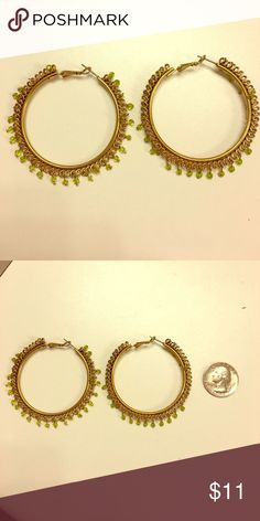 Large gold hoops with light green beads Large gold hoops with light green accent beads. From Forever21. Forever 21 Jewelry Earrings