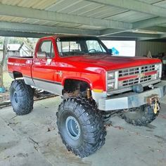 """Red lifted Chevrolet truck with Chevy """"Bow-Tie"""""""