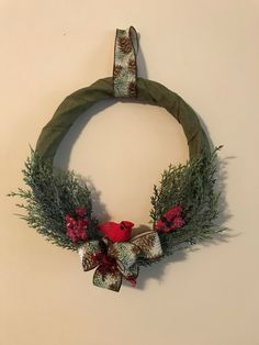 Wreath made with pine, Pinecones, berries and a Cardinal. Tied with a holiday ribbon that has sprigs of pine and Pinecones. Xmas Wreaths, Grapevine Wreath, Scented Pinecones, Red Berries, How To Make Wreaths, Love And Marriage, Soy Candles, Pine Cones, Branches