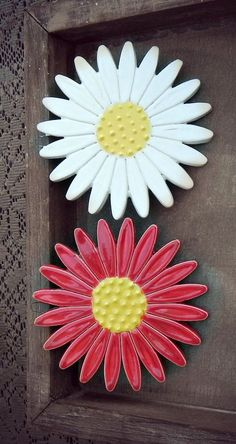 A personal favourite from my Etsy shop https://www.etsy.com/listing/247127616/ceramic-daisy-wall-decoration-red-flower