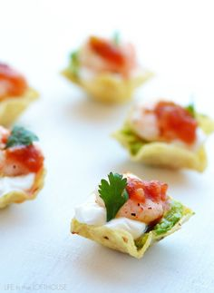 Shrimp Taco Bites are little pieces of appetizer heaven. They are perfect finger-foods for any holiday party or football Sunday!    The shrimp are soaked in my favorite Honey Lime Shrimp marinade, then quickly pan fried. Place the shrimp on a scoop tortilla chip with some sour cream and guacamole. Easy peasy...Read More »
