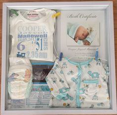 Newborn shadow box I made.. Kmart shadow box and personalise items- nappy, hospital wrist band, hospital photographer birth certificate, first outfit, card from their hospital bed, ultrasound and a special onesie with their birth details