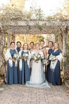 Bride and her bridesmaids in long winter slate blue dresses and cream shawls Slate Blue Bridesmaid Dresses, Bridesmaid Shawl, Dusty Blue Bridesmaid Dresses, Blue Dresses, Winter Wedding Bridesmaids, Bridesmaids And Groomsmen, Blue Wedding, Bridesmaid Inspiration, Winter Wedding Inspiration
