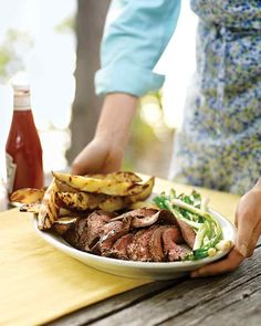 Grilled Flank Steak with Scallions--Crowd-pleasing flank steak gets marinated overnight in soy and garlic before being given a quick turn on the grill.