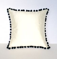 Ivory Silk Black Pom Pom Square Cotswold Cushion - Front