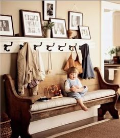 I showed this picture to my husband from one of my magazines.  So we went to Home Depot, picked out the stuff and he made it for us. It's in the entry as you come in the front door.  Got the exact same hooks from Hobby Lobbby for $2.99 each! #foyerdecoratingbench