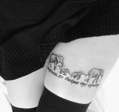 """Greek quote meaning ""family…the miracle of love."" My parents met in Greece and we go back to the hotel they met at every year, the family of elephants represent our family and how my parents protect us."" On Emma."