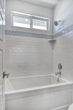 Image result for subway tile small bathroom. Love the subway tile mixed with the blue gray Moroccan trellis.