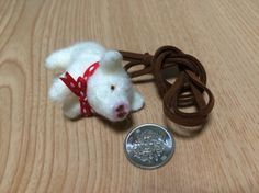 羊毛フェルトで作ったネックレスです。真っ赤なリボンがアクセントとなって可愛いです。|ハンドメイド、手作り、手仕事品の通販・販売・購入ならCreema。