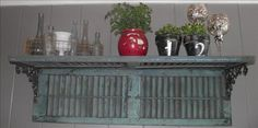 2 shutters, couple brackets......shabby chic shelf!