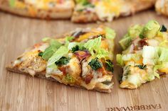 Baja Chicken Pizza  ½ cup ranch salad dressing  1/8 cup salsa  ½ tablespoon lime juice  1 ½ tablespoons cilantro  2 boneless skinless chicken breasts  1 (1.25 ounce) envelope taco seasoning  1 prebaked 12-inch thing pizza crust  ½ cup tomato (chopped)  ½ cup red onion (chopped)  2 cups shredded Mexican cheese blend  2 cups shredded lettuce  2 medium ripe avocados (peeled and thinly sliced)