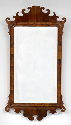 George III walnut fret mirror, the rectangular wide beveled plate within a molded surround, shaped frame with eared crest and c-scrolls top and shaped pendant below.      England Circa 1820     Height: 41"