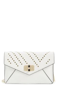 This gorgeous envelope clutch from Diane von Furstenberg features shining metal grommets, a pebbled finish crafted from supple leather, and adjustable chain strap