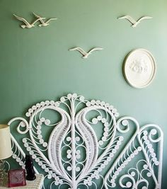 White wicker headboard against a mint green wall. Vintage Seagull decoration on the wall White Headboard, Wicker Headboard, Wall Headboard, Painted Headboard, Wicker Dresser, Wicker Couch, Wicker Trunk, Wicker Shelf, Wicker Bedroom