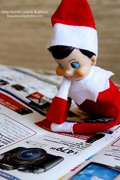 Elf gazing at what he wants for Christmas #elfontheshelf #holiday