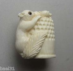 One of a Kind Carved Squirrel on Sewing Thimble, one of my all time favorite carvings.  For sale on ebay