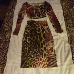 2 piece K Too skirt with Long Sleeved Crop Top K Too. Medium Long Sleeved Crop Top.  Small skirt. 2 pieces. One price. Animal print. Burgundy and Gold. K Too  Skirts Skirt Sets