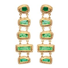 Luminosity 20k earrings with sliced emerald ladder design with rose-cut diamonds; $35,000; Coomi, Secaucus, N.J., 866-867-7272; coomi.com