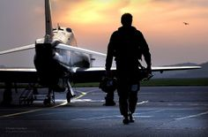 RAF Pilot Walking Away from Hawk Aircraft in Silhouette by Defence Images