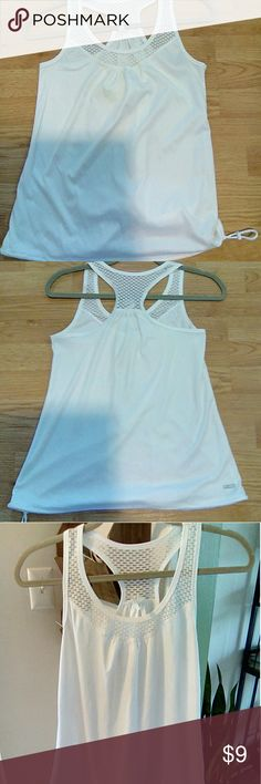 White razor back tank with mesh Has a draw string at the bottom. Never worn. Danskin Now Tops Tank Tops