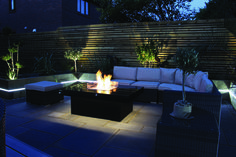 The Madrid Gas Fire Table is powered by the Rivelin PF50 18kw pre-aerated burner. This table was installed in a private client's garden in Warrington. The table was built with a polished Nero Assuluto granite top sat on a black textured RAL9005 powder-coated base with warm white under table LED's. The table was installed with our unique ceramic ice fuel bed.