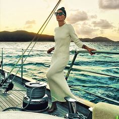 Giovanna Battaglia looks ultra cool in a long sleeved maxi dress and cat eye shades