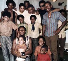 Jackie, Michael, and Marlon with cousins and uncles