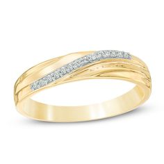 """Say """"I love you"""" with this sparkling anniversary band. Created in warm 10K gold, this slender band features grooved detailing and a ribbon of shimmering diamond accents that sweep across the center on the diagonal. Lovely alone or paired with her wedding rings, this anniversary band is finished with a bright polished shine."""