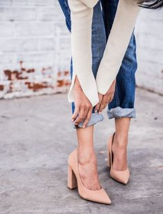 Pointed nude heels and cuffed denim.