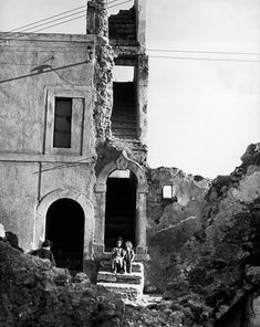 David Seymour ITALY. Naples. Two girls on the step of a bombed building. 1948.