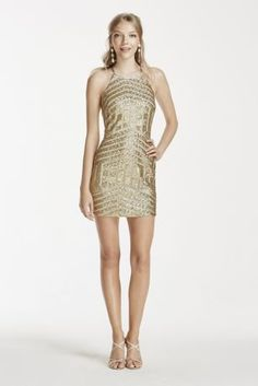 Steal the spotlight at this year's Homecoming as you dance the night away in this eye-catchingshort sequindress!  High neck halter sheath dress is decked out with shimmerimg metallic sequins in a simple yet trendy linear pattern.  Fitted mini skirt and alluring keyhole back add a seductive finish.  Designed by My Michelle.  Fully lined. Imported polyester. Back zipper. Hand wash and lay flat to dry.