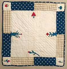"""Exquisitely delicate, unique doll quilt with eight different applique designs. Heart and basket are especially dear. Basket is 3/4"""" in height. Pennsylvania origin; circa 1870."""
