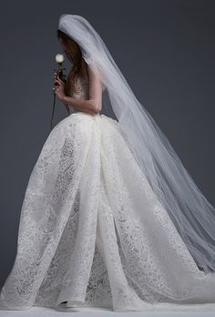 "Brides.com: . ""Juliette,"" Light ivory macrame lace ball gown with draped skirt and hand placed macrame lace and bridal button accents by Vera Wang"