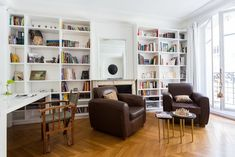 Eccentric Eclectic Style Apartment in Paris with African Motifs Parquet Chevrons, Library Ladder, Paris Apartments, Closet Storage, Eclectic Style, Apartment Interior, House Tours, Bookcase, Shelves