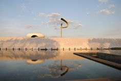 The tomb of President Juscelino Kubitschek, designed by Oscar Niemeyer, provided the late leader with a fitting resting place in the modern city that he helped create. A statue of the founder rests atop a large, question-mark shaped sculpture. #dwell #moderndesign #modernarchitecture