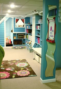 love the bright colors in this basement playroom. a little too girly for my tastes, but inspiration, nonetheless.