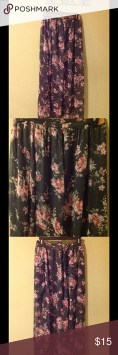 Hollister floral maxi skirt large NWT Hollister floral maxi skirt size large. It is gray with pink floral print. It is lined half. Overtop is sheer material. Elastic waist. It is new with tags. Hollister Skirts Maxi