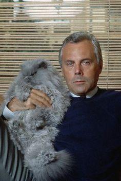 Giorgio Armani and a grumpy cat. Haute cat-ture.  That cat is a true siren!  Work it girl!