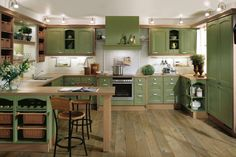 Green cabinets kitchen design - Free Interior House Design Pictures, Images, Photos and Articles Green Kitchen Interior, Green Country Kitchen, Olive Green Kitchen, Green Kitchen Designs, Green Kitchen Decor, Green Kitchen Cabinets, Green Interior Design, Country Kitchen Designs, Kitchen Cabinet Design