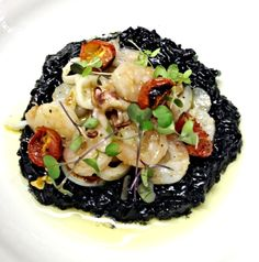 Squid ink risotto with baby shrimp & garden cherry tomatoes (I also have a bag of frozen crawfish tails...)